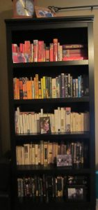 This is one of my bookshelves. Notice the lack of color!